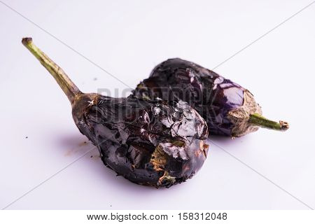 roasted eggplants or bhuna baigan in hindi, isolated over white background, selective focus