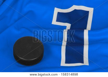 Washer and blue hockey jersey with the number one. Texture background hockey