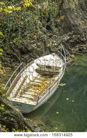 White lonely boat in the river in autumn day