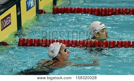 Hong Kong China - Oct 29 2016. Olympian swimmer Evelyn VERRASZTO (HUN) and CHEN Szu-Chi (TPE) after finishing 200m backstroke. FINA Swimming World Cup Preliminary Heats Victoria Park Swimming Pool.