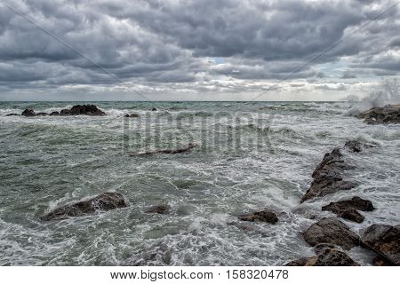Sea In Tempest On Rocks Of Italian Village