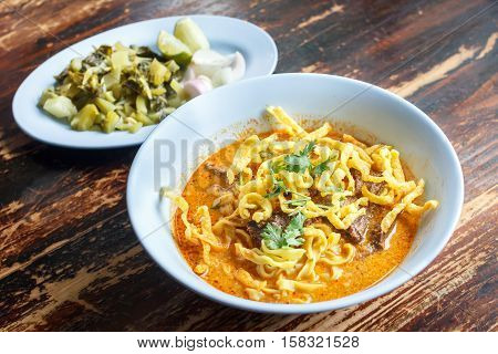 Curried Noodle Soup (Khao soi) with spicy coconut milk Noodle Soup with beef. Curried noodle. Noodle Thai cuisine northern style. Thai food.