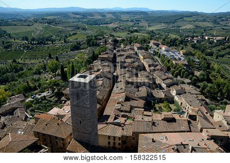 San Gimignano Italy - September 6 2016: Aerial view of San Gimignano city in Tuscany Italy. Unidentified people visible.