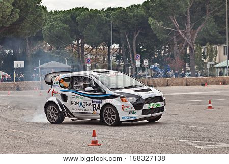 SAN PIETRO IN VINCOLI, RAVENNA, ITALY - OCTOBER 23: driver on a powerful racing car Mitsubishi Colt 4WD with Evo engine 530 hp power in action with smoking tires in