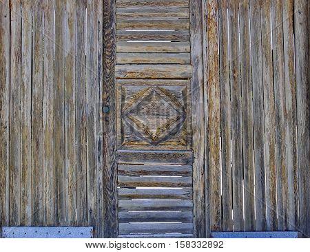 vintage wooden brown door with rhomb closeup