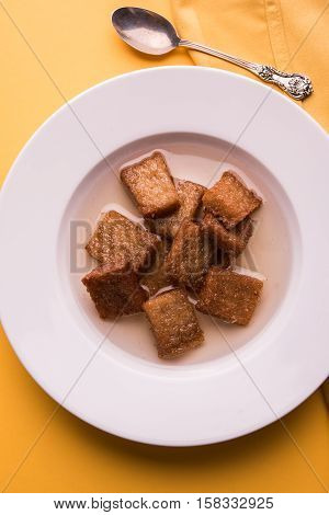 Caramelized sweet Toast or meetha or meethe toast dipped in sweet syrup or bread gulab jamun is a popular sweet dish, also known as shahi Tukda, selective focus