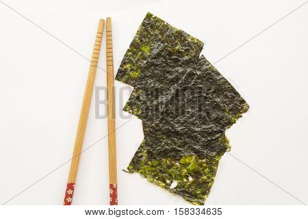 dried seaweed food to help with health weight loss on background white