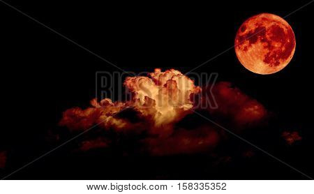 Night sky and a full moon in the clouds blood moon concept