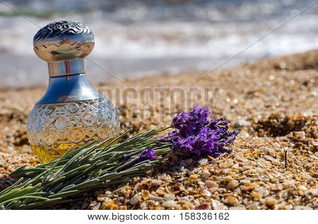 Bottle Of Aromatic Oil On The Beach