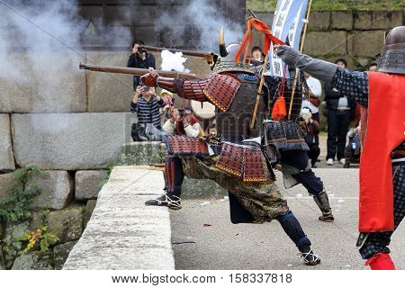 KAGAWA, JAPAN - NOVEMBER 20: Ancient firelock rifle fighters at Marugame Historical battle Festival, event dedicated to Japanese culture and tradition at Marugame-castle on November 20, 2016 in Japan.