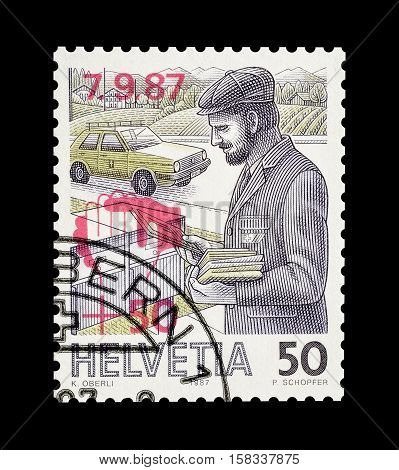 SWITZERLAND - CIRCA 1987 : Cancelled postage stamp printed by Switzerland, that shows Postman.