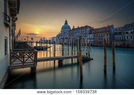 Amazing View Of The Grand Canal And Basilica Santa Maria Della Salute During Sunrise With Calm Water