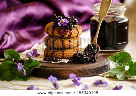 Cookies With Elderberry Jam On A Purple Background
