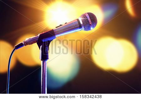 Microphone On Microphone Stand With Lights In The Background