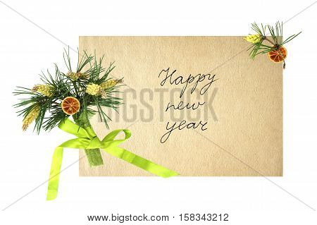 New year card with a bouquet of pine branches and a handwritten inscription