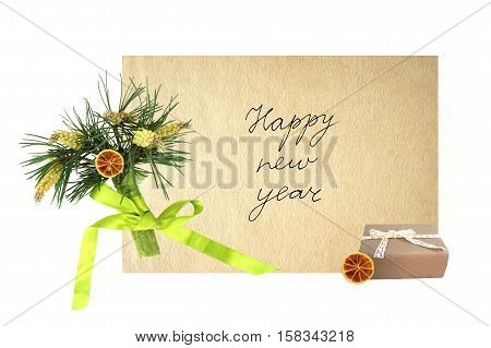 New year card with a bouquet of pine branches, box of gift and a handwritten inscription