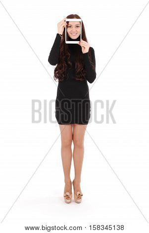 Smiling teenage girl with digital tablet making selfie isolated on white