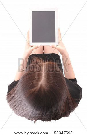 Teenage girl holds tablet computer view from above isolated on white