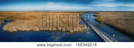 Panoramic view of Point Pelee national park boardwalk in the fall, Ontario, Canada