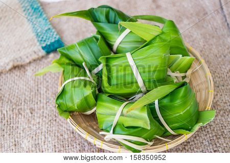 Traditional Thai food style Thai dessert made from banana and glutinous rice wrap with pandan (Khao Tom Mat)
