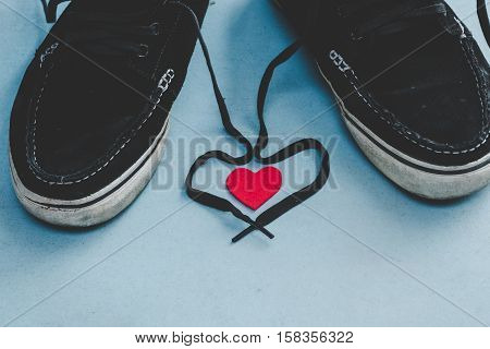 love with laces on shoes. Original Valentine's Day love concept, vintage