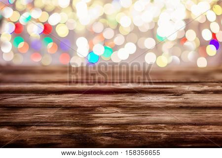 Old Empty Table With Christmas Lights In The Background