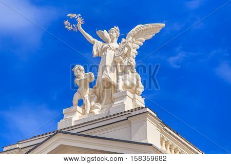 Zurich, Switzerland - 25 May, 2016: one of the sculptures decorating the top of the Zurich Opera House building. Zurich Opera House has been the home of the Zurich Opera since 1891.