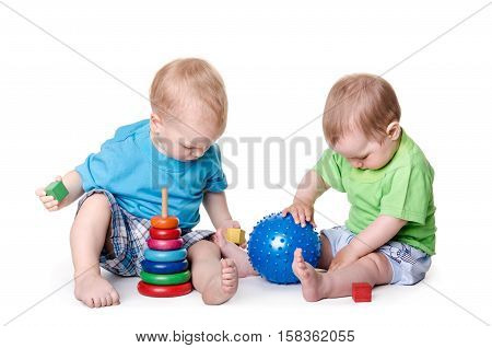 kids playing with educational toys. Isolated on white background