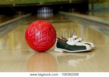 Bowling Ball And Bowling Shoes On Bowling Alley