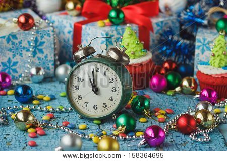 Christmas Clock And Cupcakes With Colored Decorations
