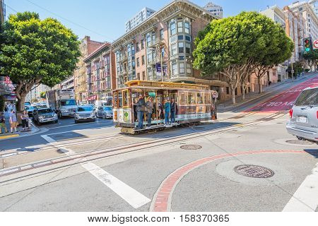 San Francisco, California, United States - August 17, 2016: Cable Car, Powell-Hyde lines, with enjoy tourists while crossing the famous Powell Street, the most famous and tourist tram line.