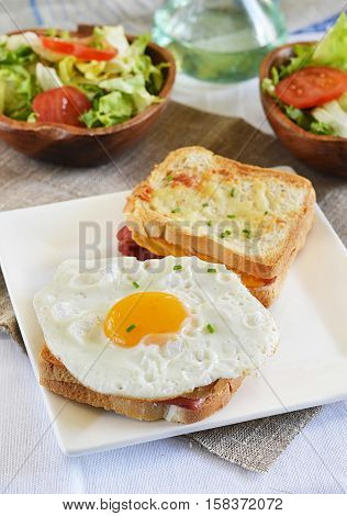 Croque-monsieur with ham and cheese served with egg