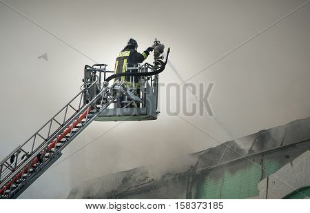 Firefighters in action fighting fire. firefighter smoke shed roof