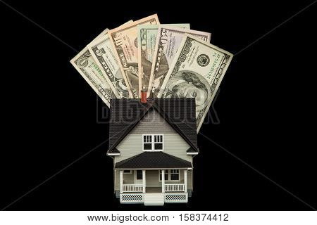 Model of a House with Money on Black Background