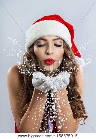 Beautiful Young Woman In A Santa Claus Hat.