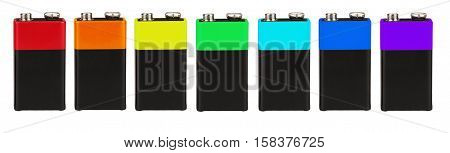 Seven batteries of the type PP3 in a row, seven colors of the rainbow (spectrum), on a white background, isolated poster