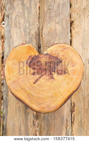 a heart shape wooden sit on a wooden floor