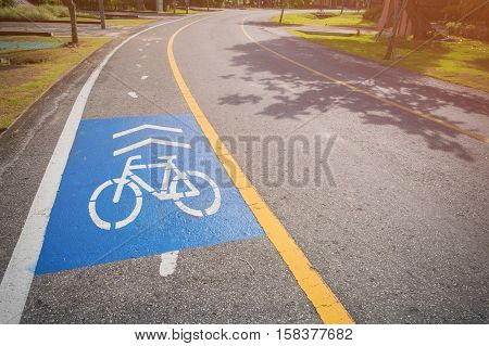 A blue cycle path on the side of the road