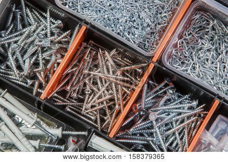 Close-up of screws and nails in a box