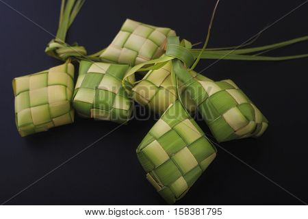 Ketupat (Rice Dumpling) On Black Background. Ketupat is a natural rice casing made from young coconut leaves for cooking rice during eid Mubarak