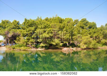 Lake in Skiathos island near Koukounaries beach Greece.