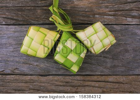 Ketupat (rice dumpling) is a local delicacy during the festive season in South East Asia. Ketupat a natural rice casing made from young coconut leaves for cooking rice..