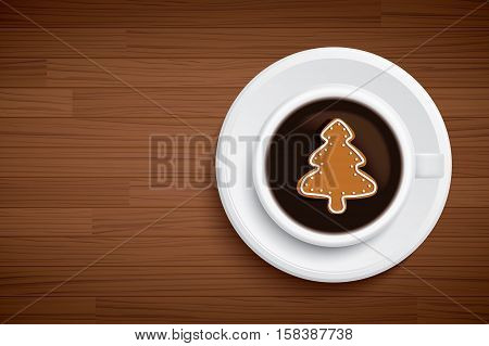 coffee mug with christmas tree shape on brown wood table