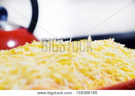 Close-up Of Shredded Cheese