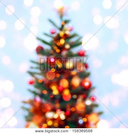 Christmas tree background with blurred sparking glowing. Happy New Year and Xmas theme
