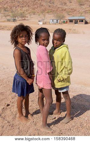 Damaraland, Namibia - August 2016: Three Herero Girls