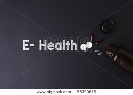 E-Health word with medicine and bottle - Health concept. Medical conceptual