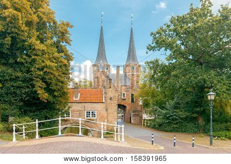 The old medieval city gate with two stone towers and bridge in Delft. Netherlands
