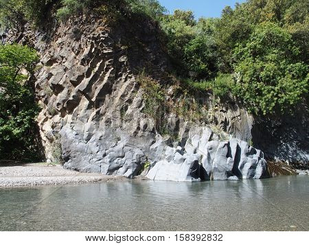 Rocks, beach and river of Alcantara Gorge in warm and sunny spring day in May 2016: SICILY / ITALY.