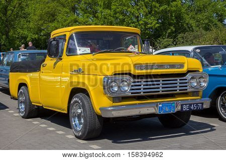 DEN BOSCH THE NETHERLANDS - MAY 8 2016: 1959 Ford F100 Pickup truck on the parking lot at the Rock Around The Jukebox event.